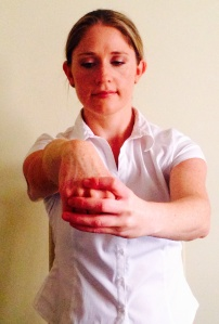 Hold the fist and gently pull back until a comfortable stretch is achieved.